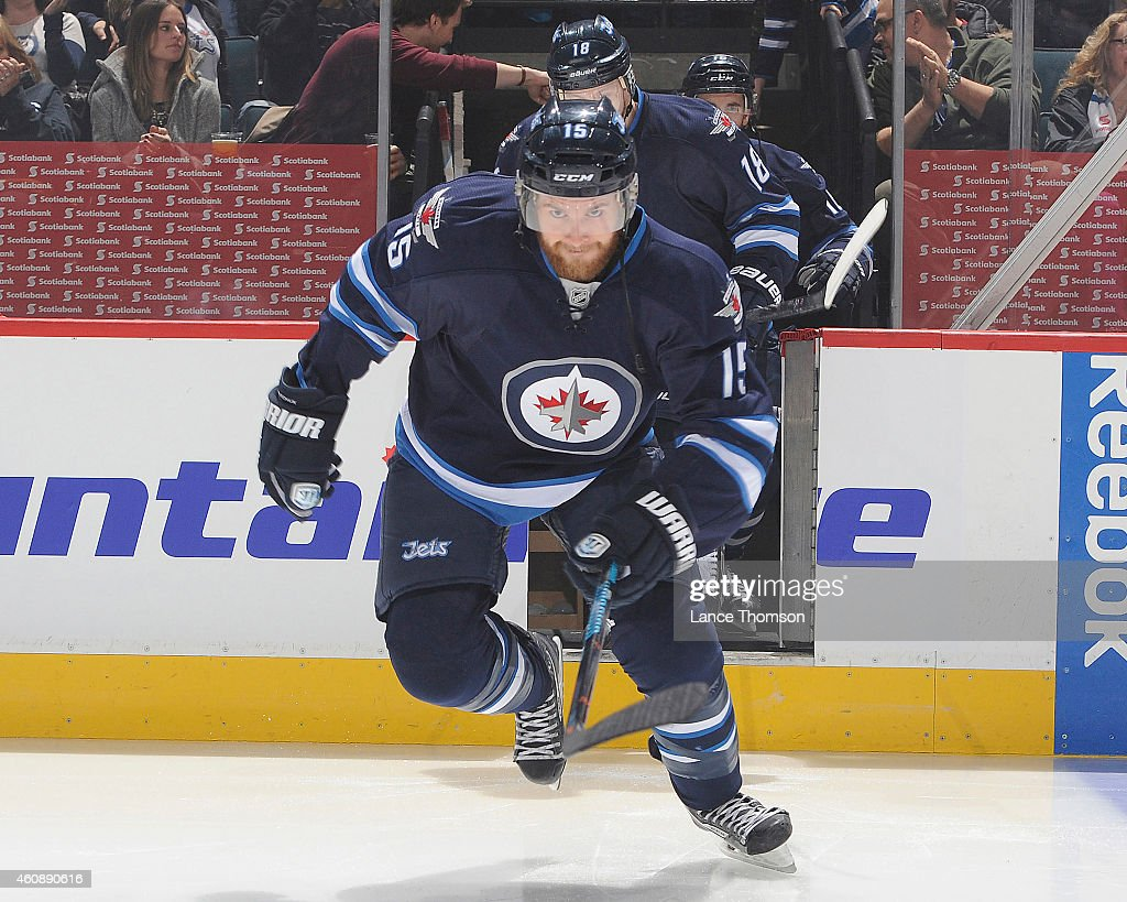 Matt Halischuk of the Winnipeg Jets hits the ice prior to puck drop against the Philadelphia Flyers on December 21 2014 at the MTS Centre in Winnipeg...
