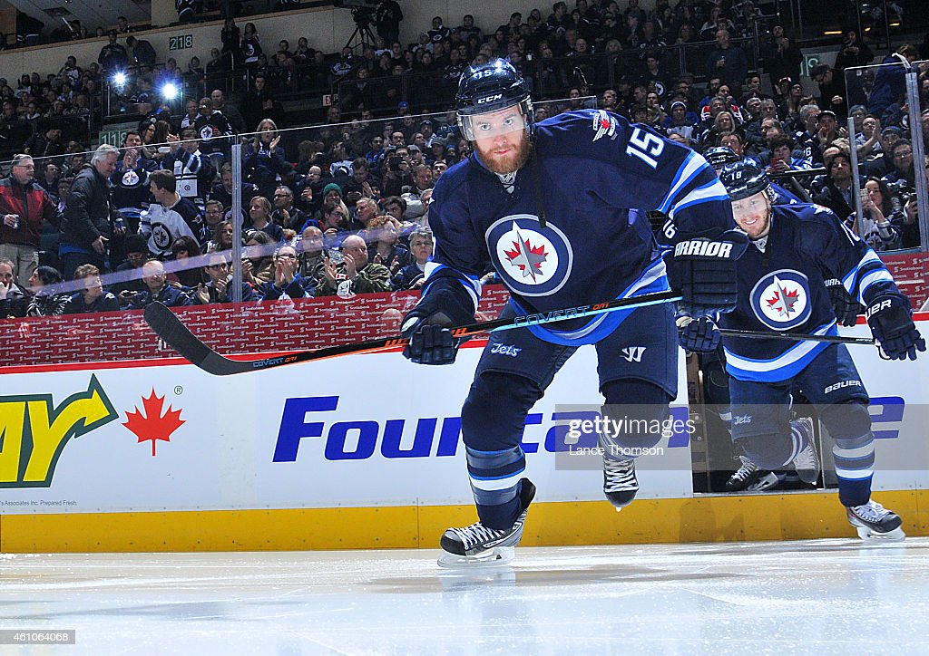 Matt Halischuk of the Winnipeg Jets hits the ice prior to puck drop against the San Jose Sharks on January 5 2015 at the MTS Centre in Winnipeg...