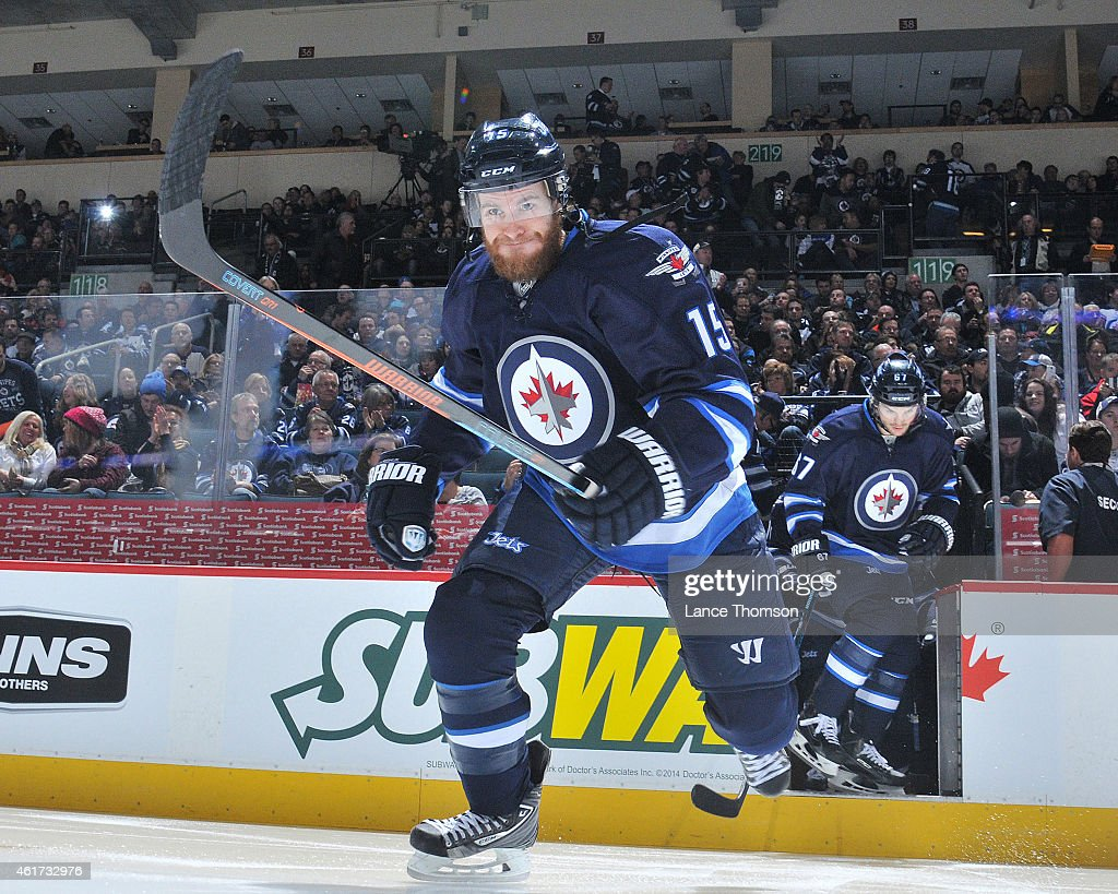Matt Halischuk of the Winnipeg Jets hits the ice prior to the NHL game against the Florida Panthers on January 13 2015 at the MTS Centre in Winnipeg...