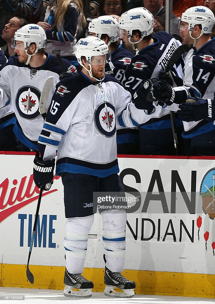 Matt Halischuk of the Winnipeg Jets is congratulated by his teammates after his firstperiod goal against the Anaheim Ducks on March 31 2014 at Honda...