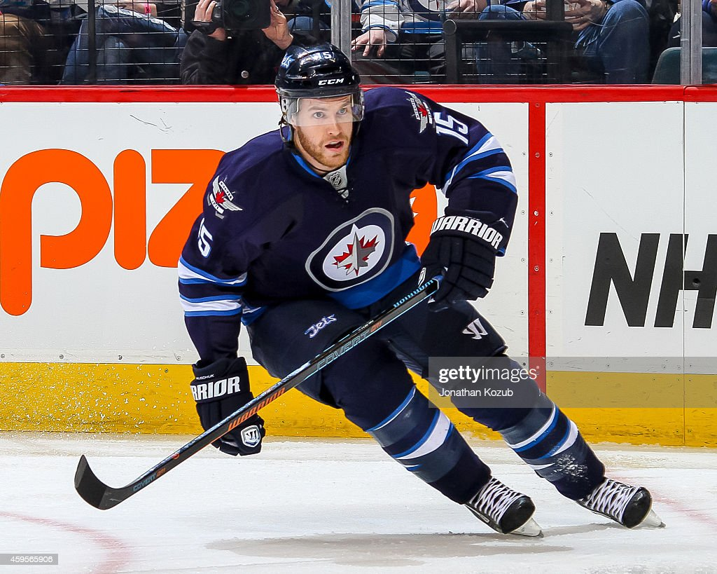 Matt Halischuk of the Winnipeg Jets keeps an eye on the play during third period action against the New Jersey Devils on November 18 2014 at the MTS...