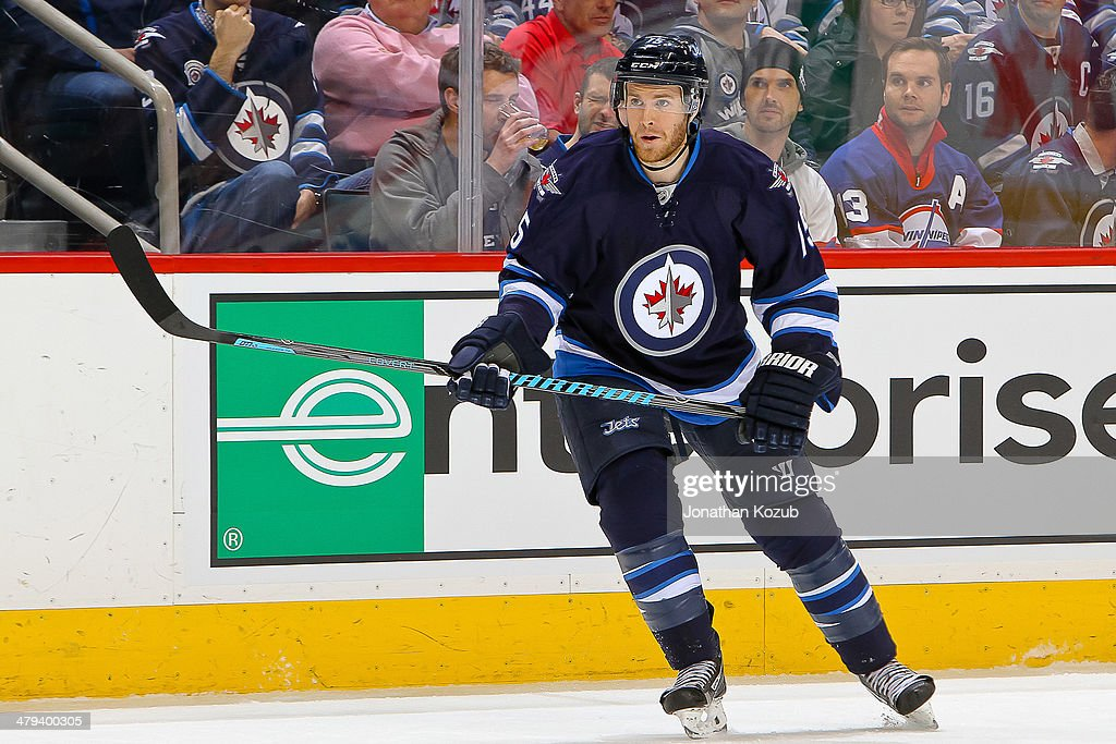Matt Halischuk of the Winnipeg Jets keeps an eye on the play during first period action against the New York Islanders at the MTS Centre on March 4...
