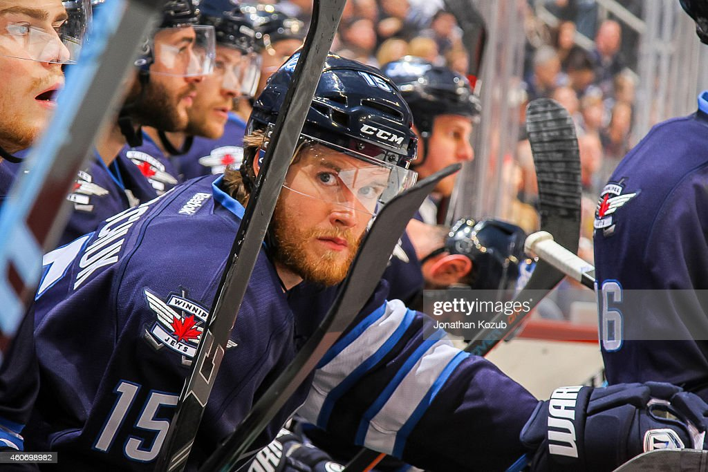 Matt Halischuk of the Winnipeg Jets looks on from the bench during third period action against the Anaheim Ducks on December 13 2014 at the MTS...