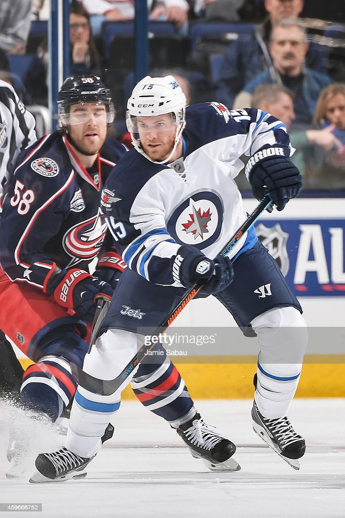 Matt Halischuk of the Winnipeg Jets skates against the Columbus Blue Jackets on November 25 2014 at Nationwide Arena in Columbus Ohio