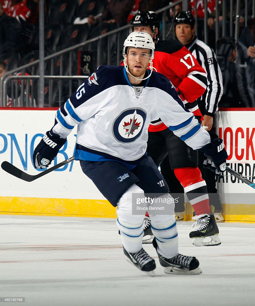 <a gi-track='captionPersonalityLinkClicked' href=/galleries/search?phrase=Matt+Halischuk&family=editorial&specificpeople=714406 ng-click='$event.stopPropagation()'>Matt Halischuk</a> #15 of the Winnipeg Jets skates against the New Jersey Devils at the Prudential Center on November 25, 2013 in Newark, New Jersey. The Jets defeated the Devils 3-1.