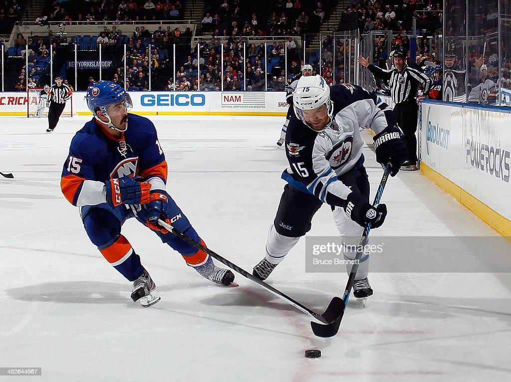 Matt Halischuk of the Winnipeg Jets skates against the New York Islanders at the Nassau Veterans Memorial Coliseum on November 27 2013 in Uniondale...