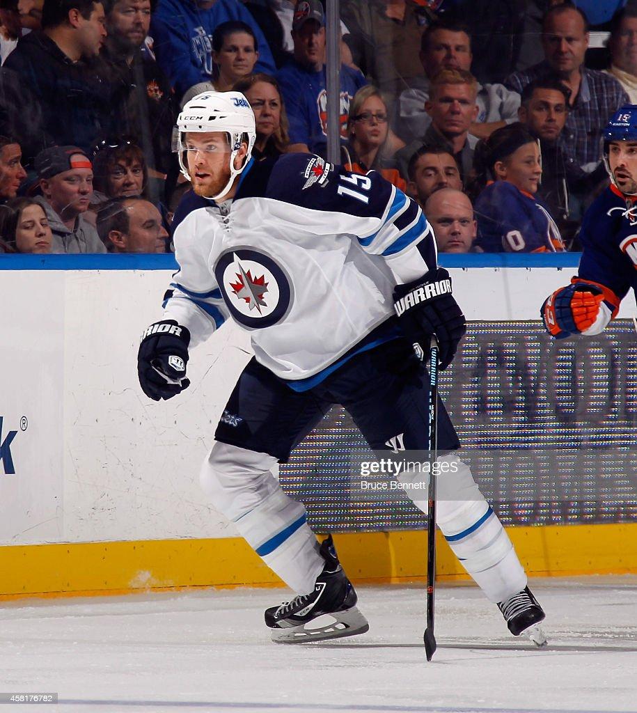 Matt Halischuk of the Winnipeg Jets skates against the New York Islanders at the Nassau Veterans Memorial Coliseum on October 28 2014 in Uniondale...