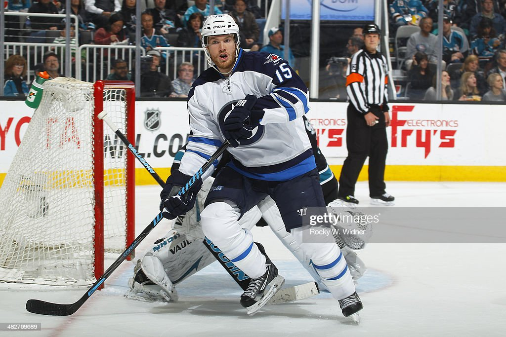 Matt Halischuk of the Winnipeg Jets skates against the San Jose Sharks at SAP Center on March 27 2014 in San Jose California