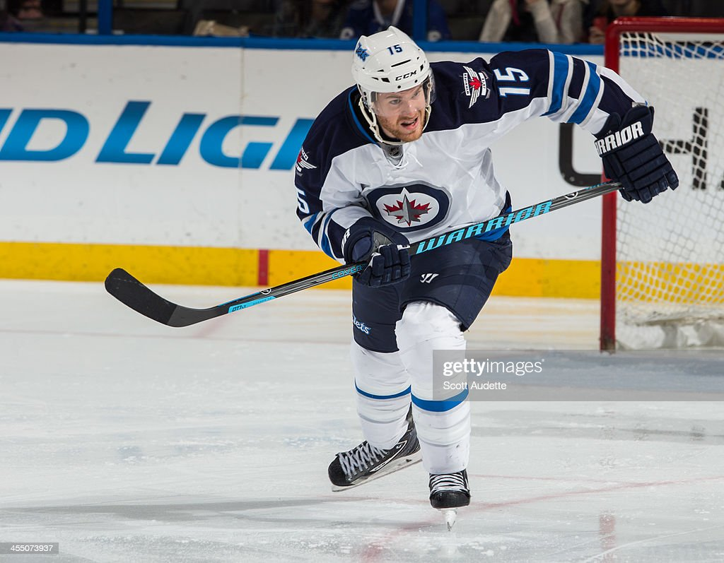 Matt Halischuk of the Winnipeg Jets skates against the Tampa Bay Lightning at the Tampa Bay Times Forum on December 7 2013 in Tampa Florida