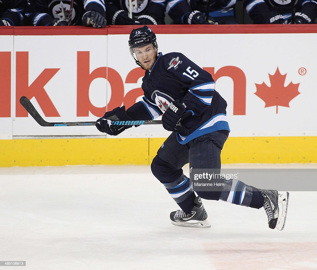 Matt Halischuk of the Winnipeg Jets skates down the ice during the first period of the NHL game against the Boston Bruins at the MTS Centre on April...