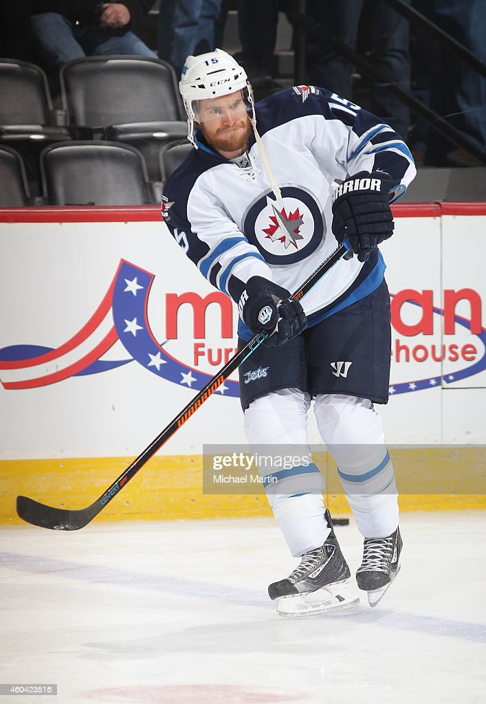 Matt Halischuk of the Winnipeg Jets skates prior to the game against the Colorado Avalanche at the Pepsi Center on December 11 2014 in Denver Colorado