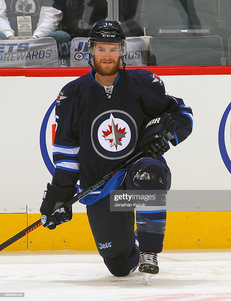 Matt Halischuk of the Winnipeg Jets takes part in the pregame warm up prior to NHL action against the Buffalo Sabres on December 16 2014 at the MTS...