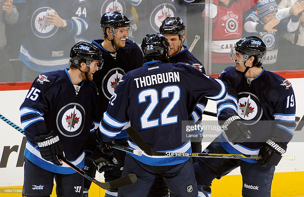 Matt Halischuk Paul Postma Chris Thorburn Adam Pardy and Jim Slater of the Winnipeg Jets celebrate a second period goal against the St Louis Blues on...
