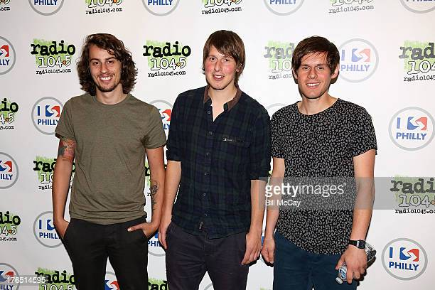 Matt Hall Michael Coles and Robert Coles of Little Comets pose at Radio 1045 Performance Theater August 14 2013 in Bala Cynwyd Pennsylvania