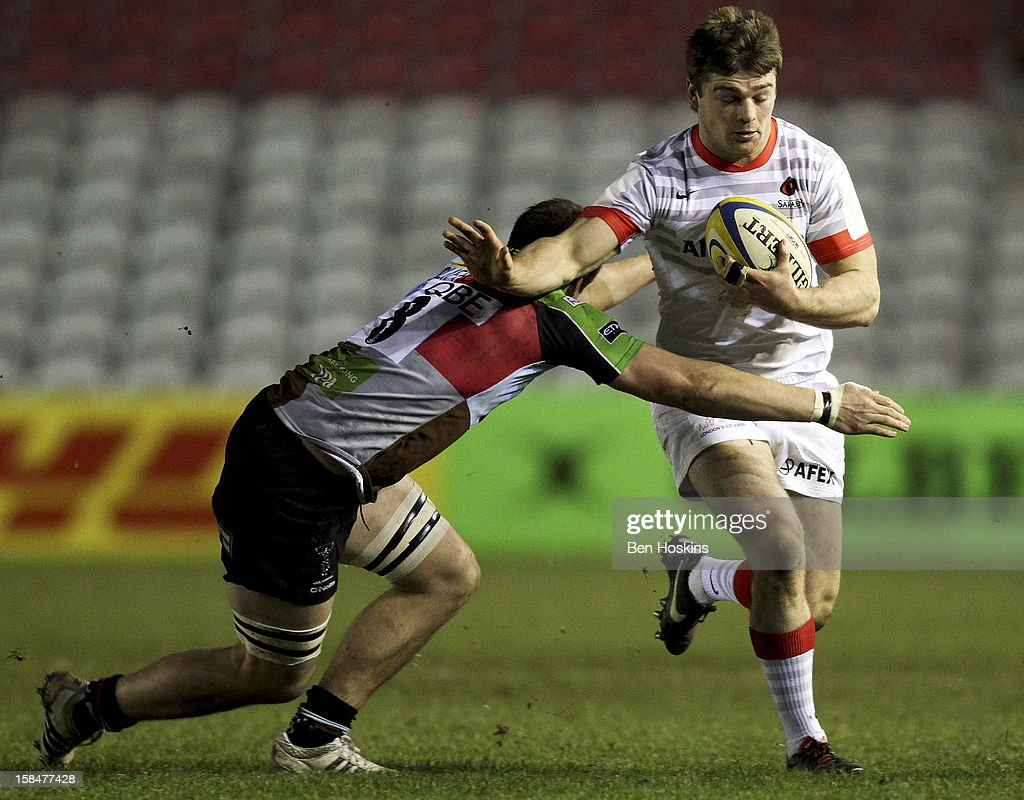 Matt Hankin of Saracens is tackled by Jack Clifford of Harlequins during the Aviva 'A' league match between Harlequins and Saracens Storm at the Twickenham Stoop on December 17, 2012 in London, England.