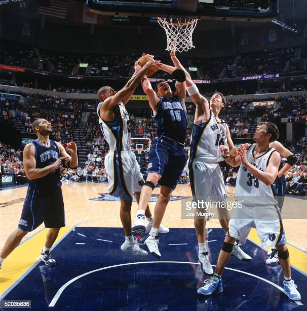 Matt Harpring of the Utah Jazz gets blocked as he goes to the basket against Shane Battier and Pau Gasol of the Memphis Grizzlies during a game at...