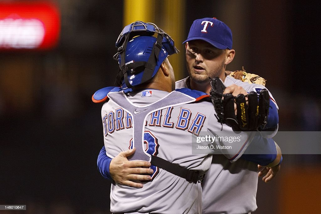 Matt Harrison #54 of the Texas Rangers is congratulated by Yorvit Torrealba after pitching a complete game shutout against the San Francisco Giants in an interleague game at AT&T Park on June 8, 2012 in San Francisco, California. The Texas Rangers defeated the San Francisco Giants 5-0.