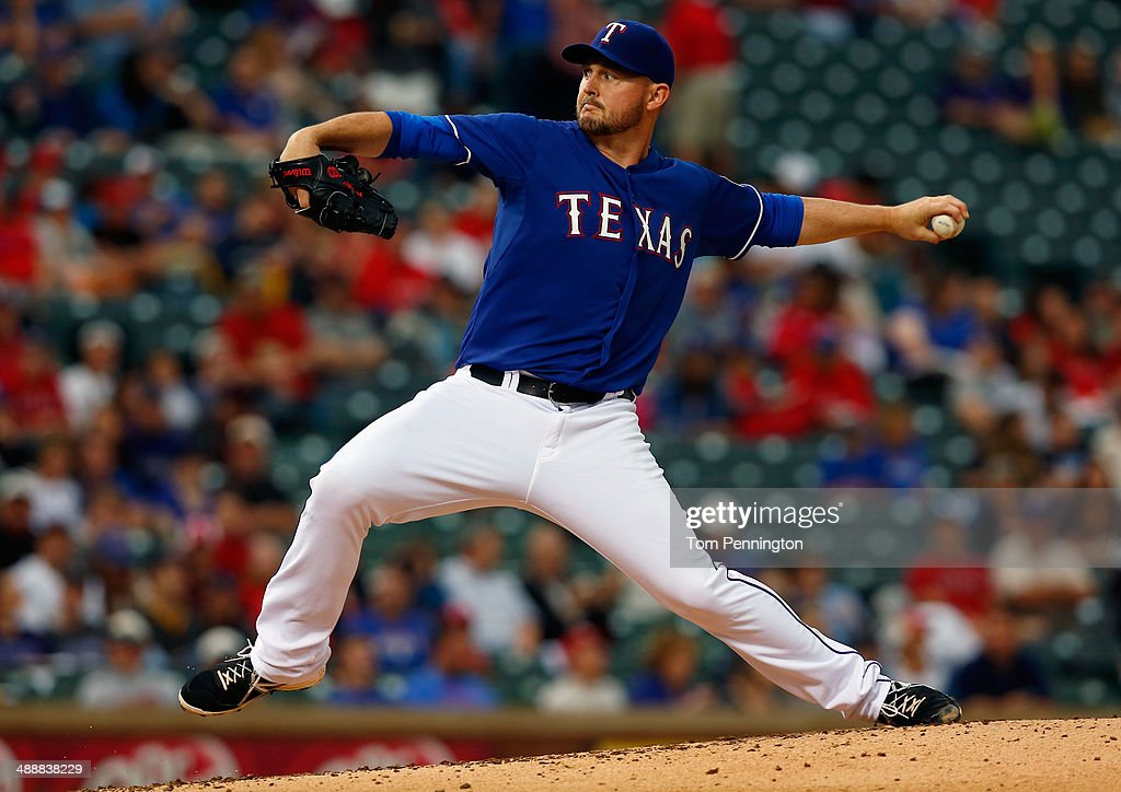 Matt Harrison #54 of the Texas Rangers pitches against the Colorado Rockies in the top of the third inning at Globe Life Park in Arlington on May 8, 2014 in Arlington, Texas.