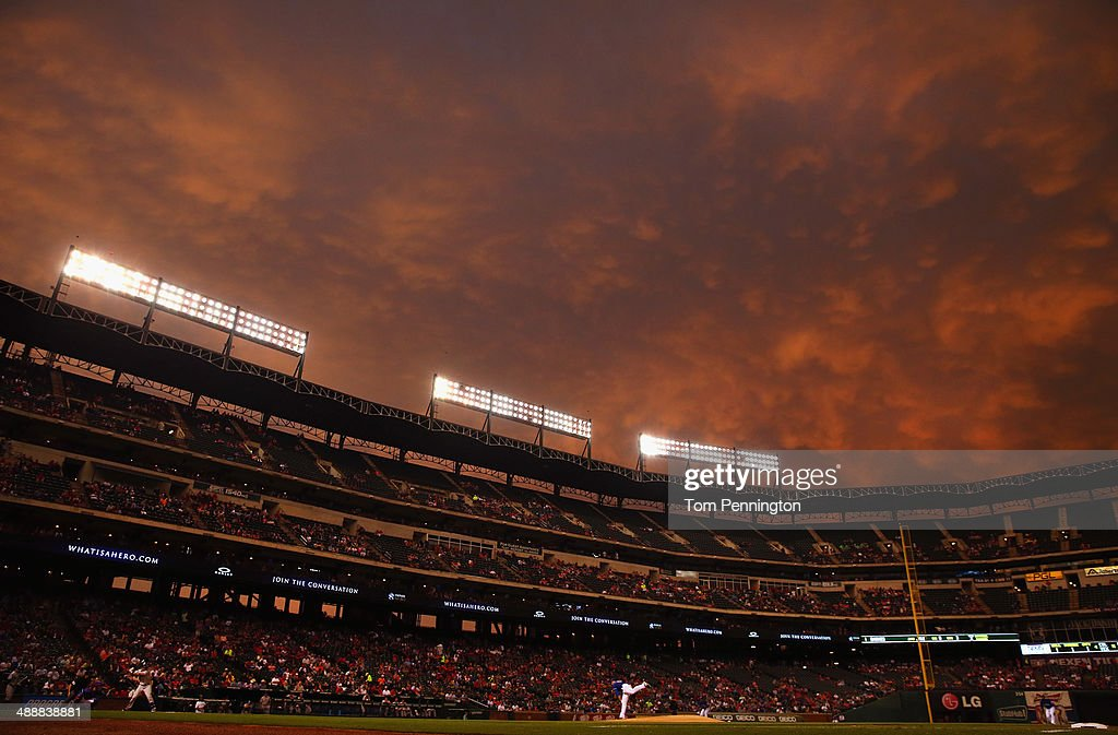 Matt Harrison of the Texas Rangers pitches against the Colorado Rockies in the top of the fourth inning at Globe Life Park in Arlington on May 8 2014...