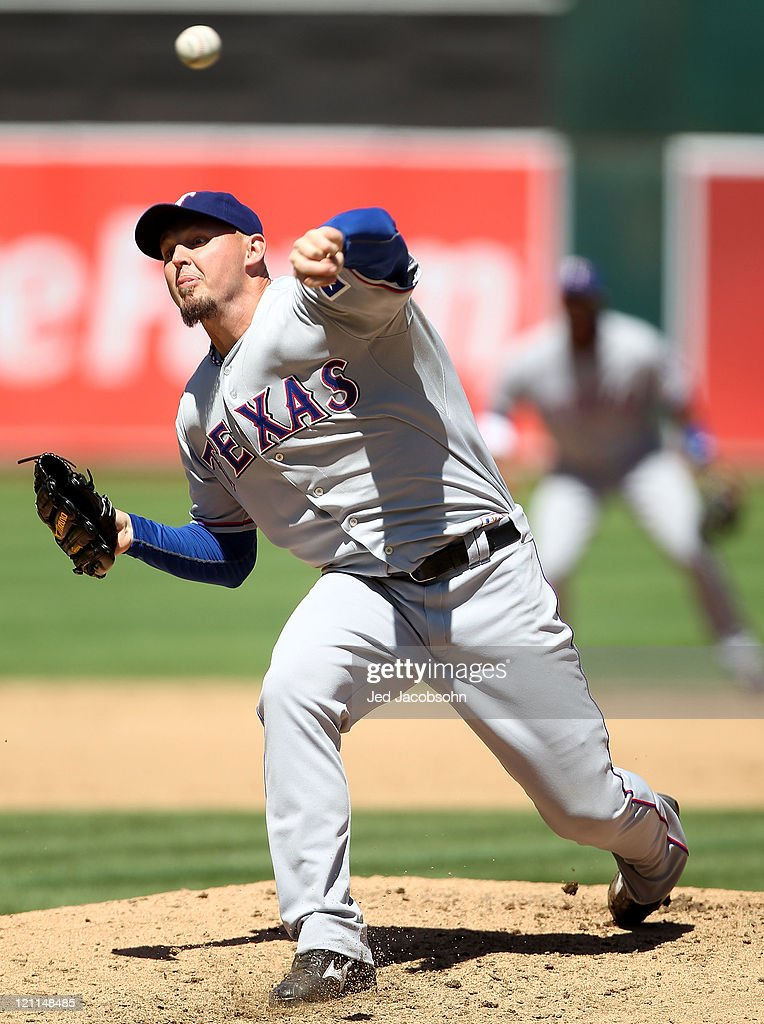 <a gi-track='captionPersonalityLinkClicked' href=/galleries/search?phrase=Matt+Harrison&family=editorial&specificpeople=4171692 ng-click='$event.stopPropagation()'>Matt Harrison</a> #54 of the Texas Rangers pitches against the Oakland Athletics at O.co Coliseum on August 14, 2011 in Oakland, California.