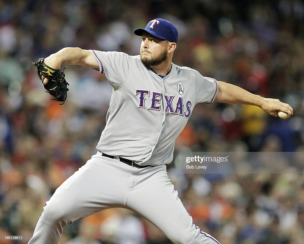 <a gi-track='captionPersonalityLinkClicked' href=/galleries/search?phrase=Matt+Harrison&family=editorial&specificpeople=4171692 ng-click='$event.stopPropagation()'>Matt Harrison</a> #54 of the Texas Rangers throws against the Houston Astros in the first inning on Opening Day at Minute Maid Park on March 31, 2013 in Houston, Texas.