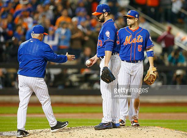 Matt Harvey of the New York Mets hands the ball to manager Terry Collins as he leaves in the ninth inning against the Kansas City Royals during game...