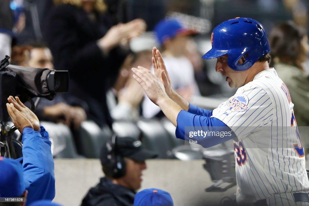 Matt Harvey #33 of the New York Mets is congraulated by teammates in the dugout after he scored a run in the fifth inning against the Los Angeles Dodgers on April 24, 2013 at Citi Field in the Flushing neighborhood of the Queens borough of New York City.