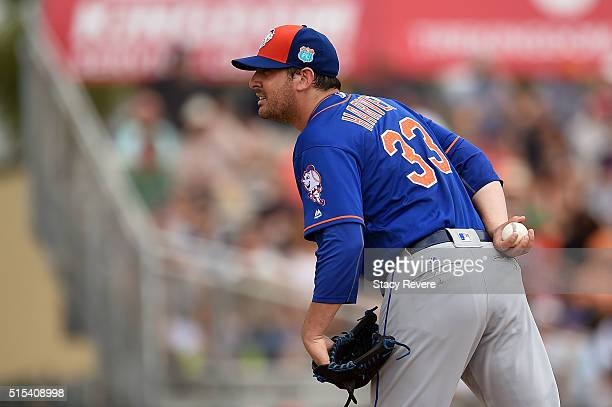 Matt Harvey of the New York Mets prepares to throw a pitch during the fourth inning of a spring training game against the Miami Marlins at Roger Dean...