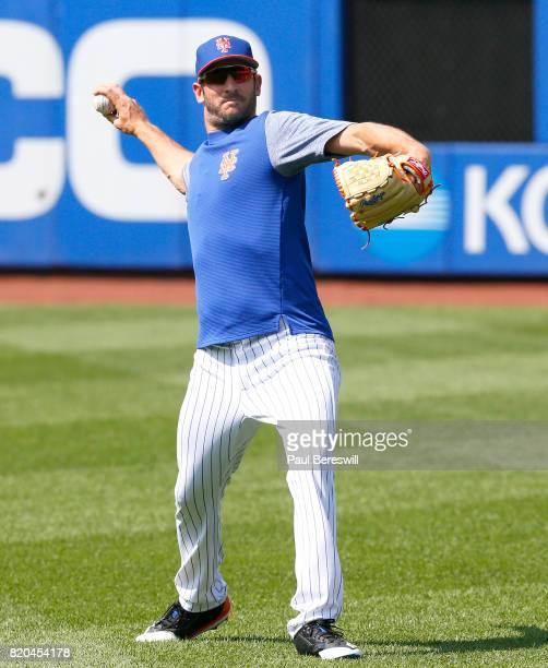 Matt Harvey of the New York Mets throws a ball to teammate Noah Syndergaard as the two injured starters threw baseballs to each other for the first...