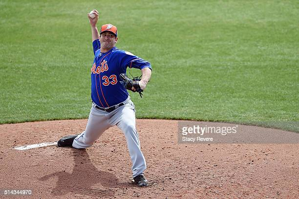 Matt Harvey of the New York Mets throws a pitch during the third inning of a spring training game against the Atlanta Braves at Champion Stadium on...