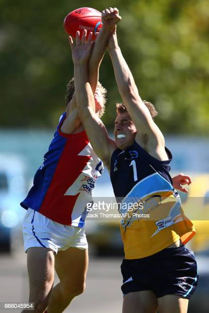 Matt Harvey of the Pioneers and Bailey Patterson of the Power compete for the ball during the round three TAC Cup match between XXXX and XXXX at...