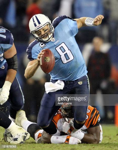 Matt Hasselbeck of the Tennessee Titans is sacked by Carlos Dunlap of the Cincinnati Bengals during the NFL game at LP Field on November 6 2011 in...
