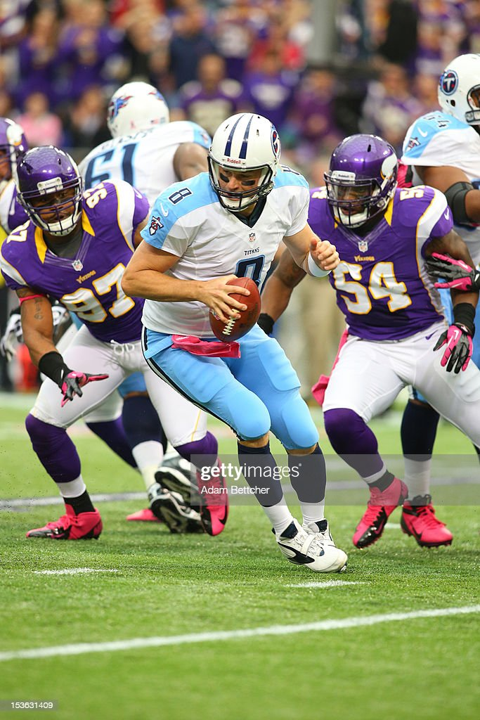 <a gi-track='captionPersonalityLinkClicked' href=/galleries/search?phrase=Matt+Hasselbeck&family=editorial&specificpeople=202628 ng-click='$event.stopPropagation()'>Matt Hasselbeck</a> #8 of the Tennessee Titans tries to get away from Everson Griffen #97 and <a gi-track='captionPersonalityLinkClicked' href=/galleries/search?phrase=Jasper+Brinkley&family=editorial&specificpeople=4032417 ng-click='$event.stopPropagation()'>Jasper Brinkley</a> #54 of the Minnesota Vikings at the Hubert H. Humphrey Metrodome on October 7, 2012 in Minneapolis, Minnesota.