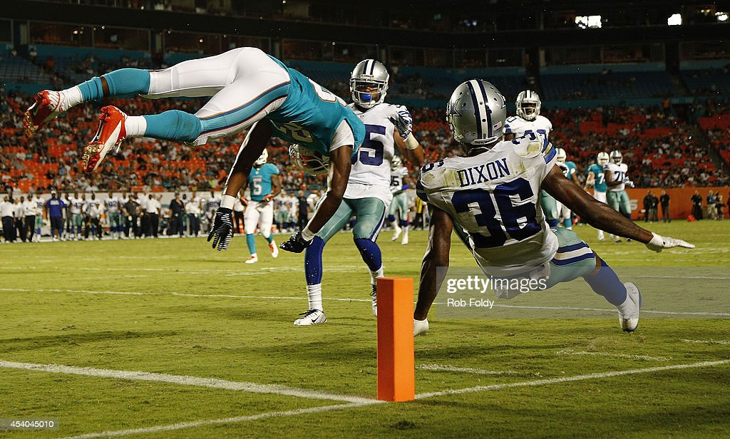 Matt Hazel #83 of the Miami Dolphins is upended with Ahmad Dixon #36 of the Dallas Cowboys on an imcomplete pass in the fourth quarter during a preseason game at Sun Life Stadium on August 23, 2014 in Miami Gardens, Florida.