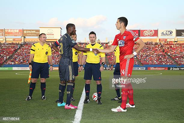 Matt Hedges of FC Dallas shakes hands with Maurice Edu of Philadelphia Union during the coin toss at Toyota Stadium on July 4 2014 in Frisco Texas
