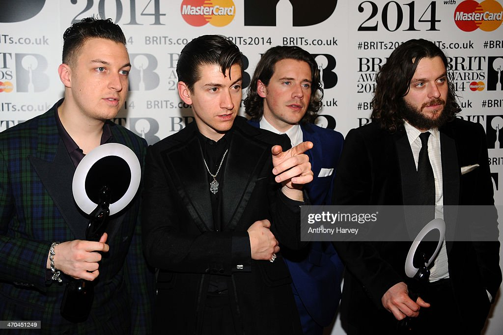 <a gi-track='captionPersonalityLinkClicked' href=/galleries/search?phrase=Matt+Helders&family=editorial&specificpeople=802484 ng-click='$event.stopPropagation()'>Matt Helders</a>, <a gi-track='captionPersonalityLinkClicked' href=/galleries/search?phrase=Alex+Turner&family=editorial&specificpeople=706618 ng-click='$event.stopPropagation()'>Alex Turner</a>, Jaime Cook and <a gi-track='captionPersonalityLinkClicked' href=/galleries/search?phrase=Nick+O%27Malley&family=editorial&specificpeople=3980120 ng-click='$event.stopPropagation()'>Nick O'Malley</a> of Arctic Monkeys, winners of the British Group and MasterCard British Album of the Year and awards, pose in the winners room at The BRIT Awards 2014 at 02 Arena on February 19, 2014 in London, England.