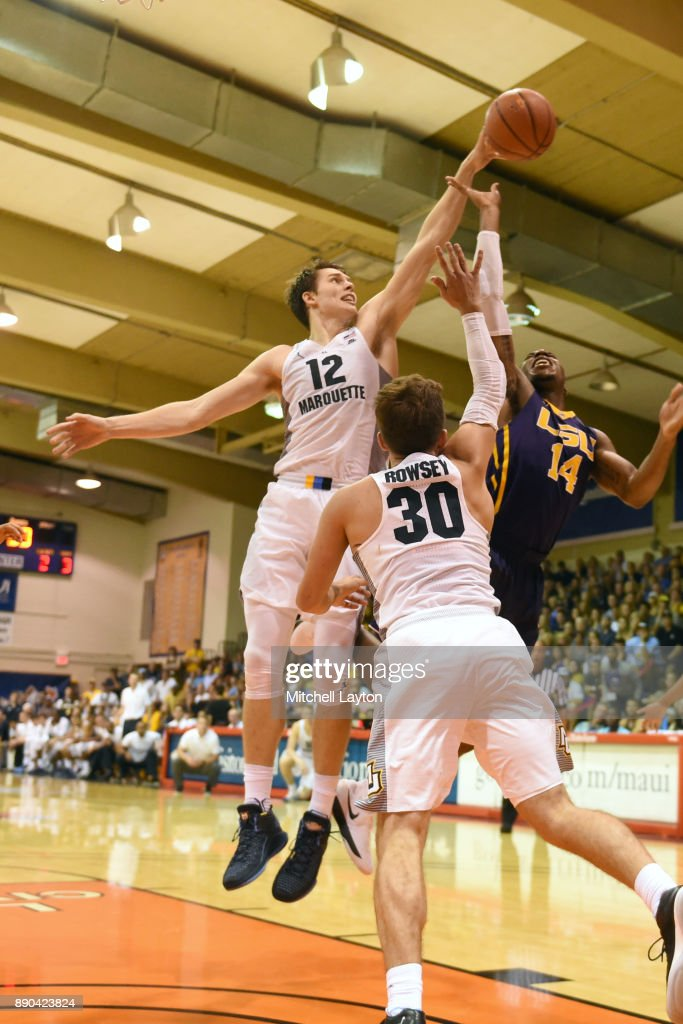 Matt Heldt #12 of the Marquette Golden Eagles blocks the shot over Wayde Sims #44 of the LSU Tigers during a consultation college basketball game at the Maui Invitational at the Lahaina Civic Center on November 22, 2017 in Lahaina, Hawaii. The Golden Eagles won 94-84.