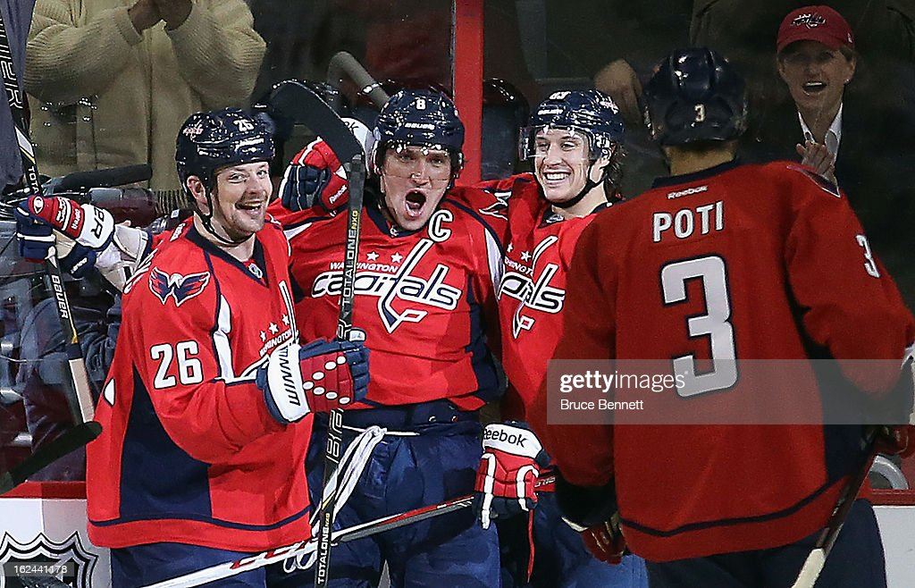 <a gi-track='captionPersonalityLinkClicked' href=/galleries/search?phrase=Matt+Hendricks&family=editorial&specificpeople=4537275 ng-click='$event.stopPropagation()'>Matt Hendricks</a> #26, Alex Ovechkin #8, Jay Beagle #83 and <a gi-track='captionPersonalityLinkClicked' href=/galleries/search?phrase=Tom+Poti&family=editorial&specificpeople=203059 ng-click='$event.stopPropagation()'>Tom Poti</a> #3 of the Washington Capitals celebrate Ovechkin's goal at 1:23 of the third period against the New Jersey Devils at the Verizon Center on February 23, 2013 in Washington, DC. The Capitals defeated the Devils 5-1.