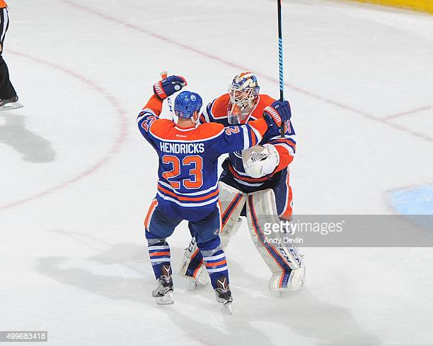 Matt Hendricks and Anders Nilsson of the Edmonton Oilers celebrate after winning the game against the Boston Bruins on December 2 2015 at Rexall...