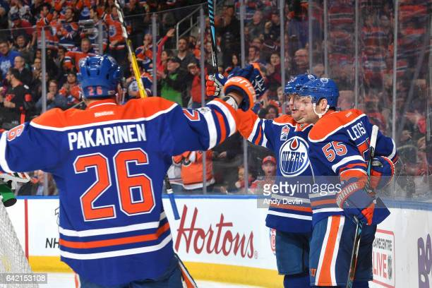 Matt Hendricks Mark Letestu and Iiro Pakarinen of the Edmonton Oilers celebrate after a goal during the game against the Philadelphia Flyers on...