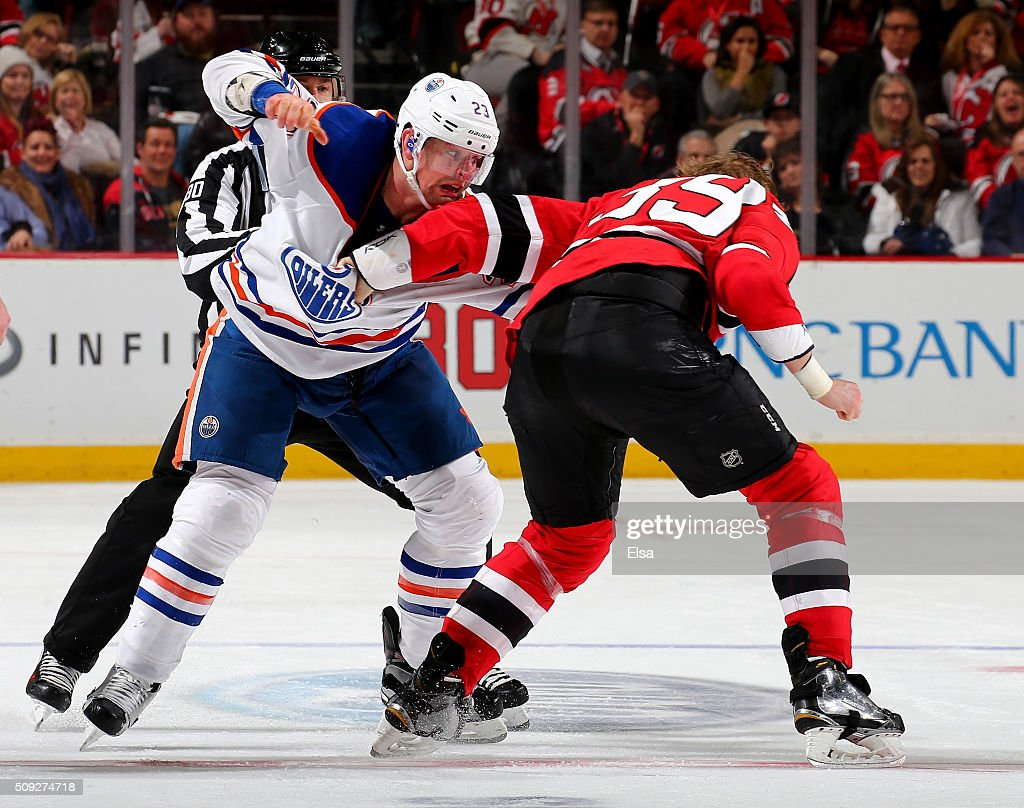 Matt Hendricks of the Edmonton Oilers and Seth Helgeson of the New Jersey Devils fight in the second period on February 9 2016 at Prudential Center...
