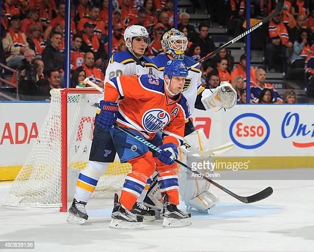Matt Hendricks of the Edmonton Oilers battles for position against Alexander Steen and Brian Elliott of the St Louis Blues on October 15 2015 at...