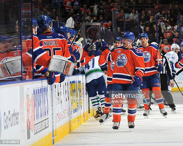 Matt Hendricks of the Edmonton Oilers celebrates with team mates after scoring a goal during the game against the Vancouver Canucks on March 18 2016...