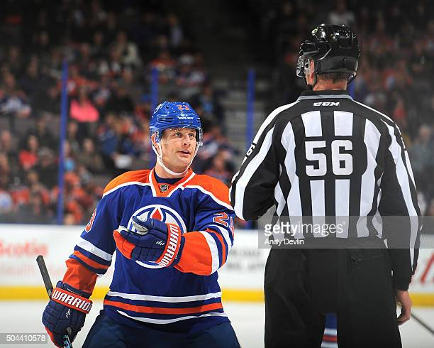 Matt Hendricks of the Edmonton Oilers exchanges words with an official during a game against the Florida Panthers on January 10 2016 at Rexall Place...