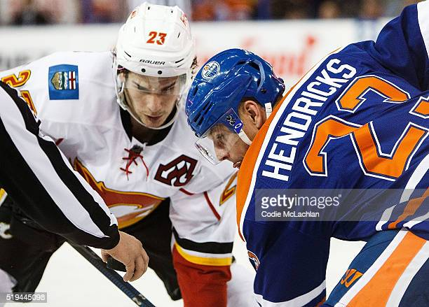 Matt Hendricks of the Edmonton Oilers faces off against Sean Monahan of the Calgary Flames on April 2 2016 at Rexall Place in Edmonton Alberta Canada
