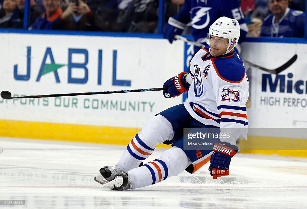 Matt Hendricks of the Edmonton Oilers falls after losing his skate blade against the Tampa Bay Lightning during the third period at the Amalie Arena...