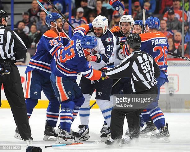 Matt Hendricks of the Edmonton Oilers fights with Dustin Byfuglien of the Winnipeg Jets on February 13 2016 at Rexall Place in Edmonton Alberta Canada