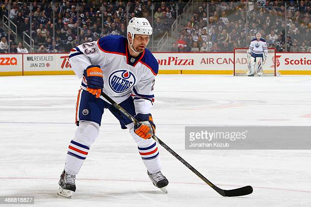 Matt Hendricks of the Edmonton Oilers keeps an eye on the play during first period action against the Winnipeg Jets at the MTS Centre on January 18...