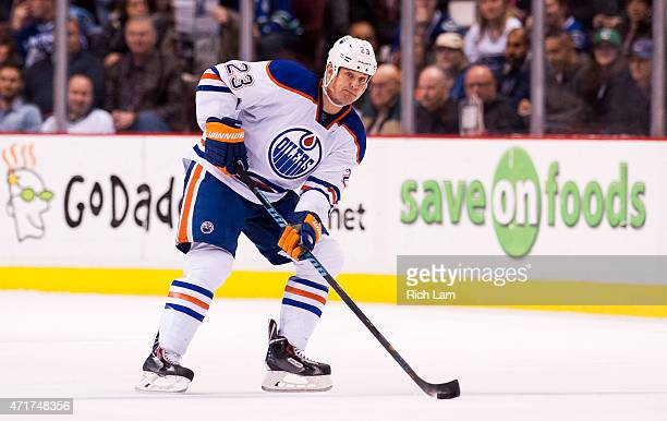 Matt Hendricks of the Edmonton Oilers skates with the puck in NHL action against the Vancouver Canucks on April 2015 at Rogers Arena in Vancouver...