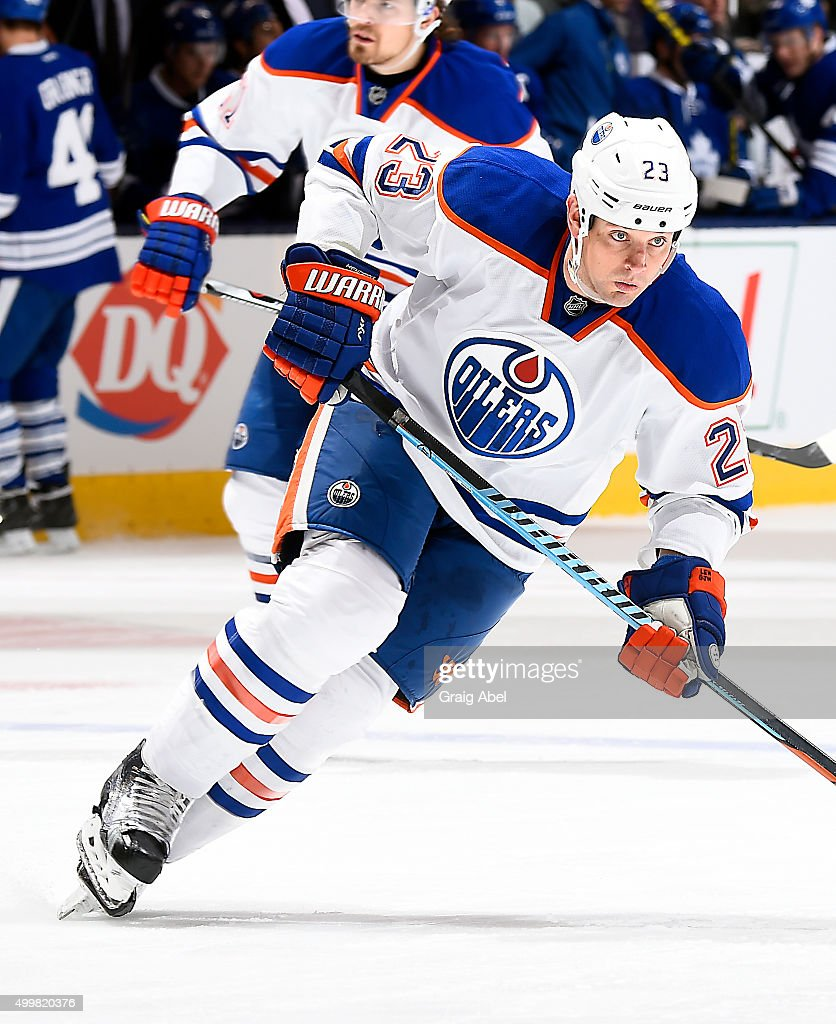 Matt Hendricks of the Edmonton Oilers turns up ice against the Toronto Maple Leafs during game action on November 30 2015 at Air Canada Centre in...